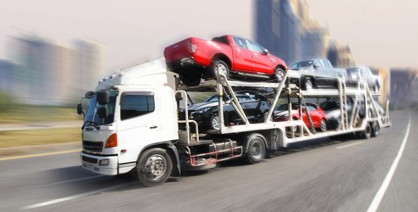 Cars loaded onto a car transporter